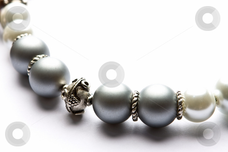 Costume Juwelery stock photo, Silver and pearl designer costume jewelery in macro on white background by Adriaan Van den Berg