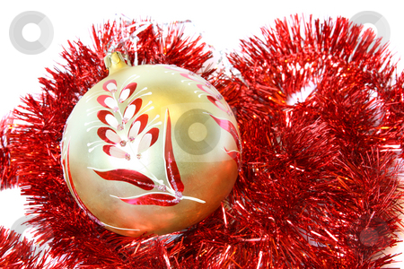 Christmas ball and a tinsel stock photo, Golden Christmas ball and red tinsel. Isolated on white by Olga Lipatova