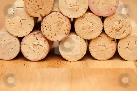 Stack of Wine Corks stock photo, Stack of Wine Corks on a Wood Surface. by Andy Dean