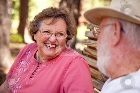 Loving Senior Couple Outdoors stock photo, Loving Senior Couple Enjoying the Outdoors Together. by Andy Dean