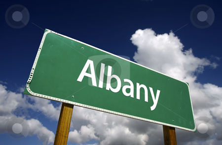 Albany Green Road Sign stock photo, Albany Road Sign with dramatic blue sky and clouds - U.S. State Capitals Series. by Andy Dean