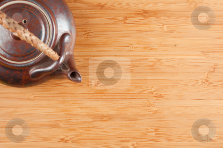 Tea Pot and Bamboo Textured Surface stock photo, Tea Pot and Bamboo Textured Surface Background with Plenty of Room for Text. Focus is on the Bamboo Surface. by Andy Dean