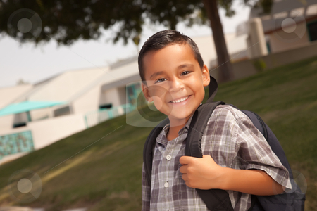 Happy Young Hispanic Boy Ready for School stock photo, Happy Young Hispanic Boy with Backpack Ready for School. by Andy Dean