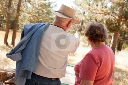 Loving Senior Couple Outdoors stock photo, Loving Senior Couple Enjoying the Outdoors Together. by Andy Dean