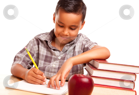 Adorable Hispanic Boy with Books, Apple, Pencil and Paper stock photo, Adorable Hispanic Boy with Books, Apple, Pencil and Paper Isolated on a White Background. by Andy Dean