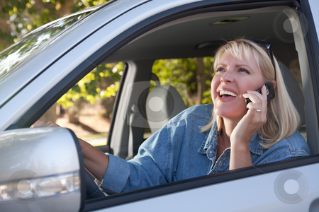 Attractive Woman Using Cell Phone While Driving stock photo, Attractive Blonde Woman Using Cell Phone While Driving by Andy Dean