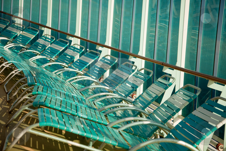 Cruise Ship Lounge Chairs Abstract stock photo, Several Cruise Ship Lounge Chairs Abstract Image. by Andy Dean