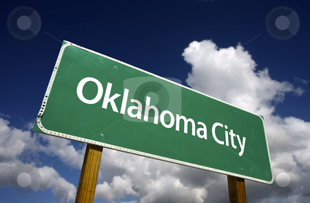 Oklahoma City Green Road Sign stock photo, Oklahoma City Road Sign with dramatic blue sky and clouds - U.S. State Capitals Series. by Andy Dean
