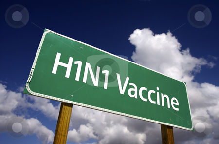 H1N1 Vaccine Green Road Sign stock photo, H1N1 Vaccine Road Sign with dramatic blue sky and clouds. by Andy Dean