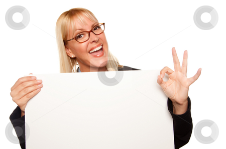 Attractive Blonde with Okay Hand Gesture Holding Blank White Sig stock photo, Attractive Blonde with Okay Hand Gesture Holding Blank White Sign Isolated on a White Background. by Andy Dean