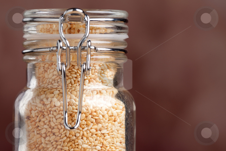 Bottle of Sesame Seeds stock photo, Glass Bottle Close-up of Sesame Seeds by Andy Dean