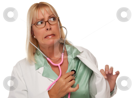 Attractive Female Doctor or Nurse Checking Her Own Heart stock photo, Attractive Female Doctor or Nurse Checking Her Own Heart Isolated on a White Background. by Andy Dean