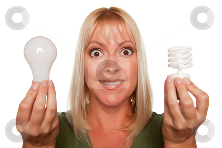Woman Holds Energy Saving and Regular Light Bulbs stock photo, Woman Holds Energy Saving and Regular Light Bulbs Isolated on a White Background. by Andy Dean
