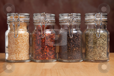 Bottles of Various Spices stock photo, Glass Bottles of Various Cooking Spices by Andy Dean