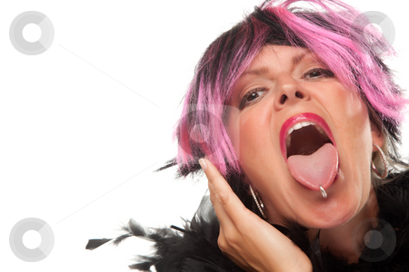 Pink And Black Haired Girl with Pierced Tongue Out stock photo, Pink And Black Haired Girl Sticking Her Pierced Tongue Out Isolated on a White Background. by Andy Dean