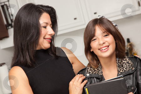 Attractive Hispanic Proud Mom with Her Pretty Schoolgirl Daughte stock photo, Attractive Hispanic Proud Mom with Her Pretty Schoolgirl Daughter in the Kitchen. by Andy Dean