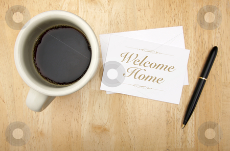 Welcome Home Note Card, Pen and Coffee stock photo, Welcome Home Note Card, Pen and Coffee Cup on Wood Background. by Andy Dean