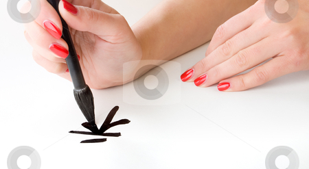 Calligraphy stock photo, Woman's hands writing Chinese hieroglyph 'happiness' by Vladimir Semenov