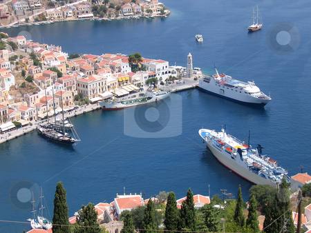 Aerial veiw on harbor of the Greek city stock photo, Aerial veiw on the vessels in the harbor of the Greek city by Olga Lipatova