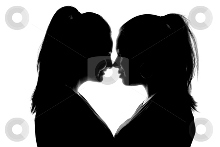 Two Women Looking Into Each Others Eyes  stock photo, A silhouette of two women gazing into each others eyes.  The composition creates a heart shape between them.  Black and white isolated on white. by Christopher Guzman
