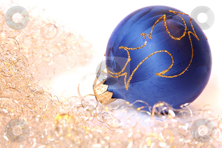 Christmas ball and a tinsel stock photo, Blue Christmas ball and golden tinsel. Isolated on white by Olga Lipatova