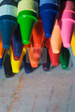 Crayons on paper stock photo, Closeup of Crayons as they are drawing on paper. by Joseph Jenkins