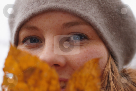 Closeup of a cute young woman looking at you stock photo, Autumns - Closeup of a cute young woman looking at you by Phillip Dyhr Hobbs