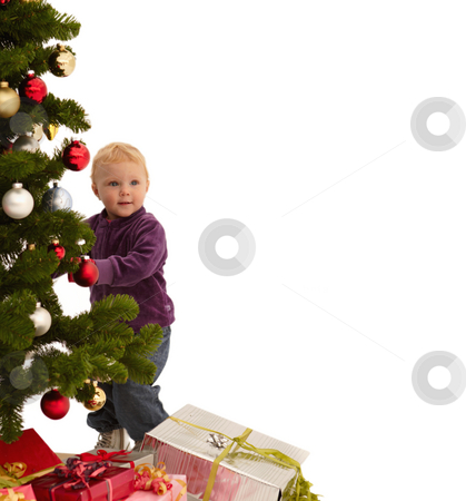 Christmas - Child putting decorations on tree stock photo, Christmas - Child putting decorations on x-mas tree by Phillip Dyhr Hobbs