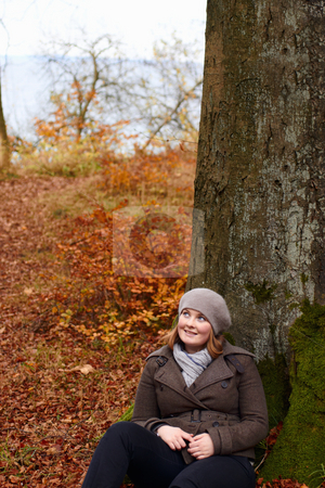 Fall - Cute young woman looking up at copyspace stock photo, Fall - Cute young woman looking up at copy space by Phillip Dyhr Hobbs