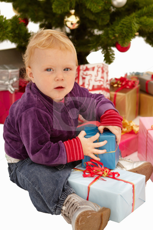 Christmas - Child caught opening gifts under tree stock photo, Christmas - Child caught opening x-mas gifts under tree by Phillip Dyhr Hobbs