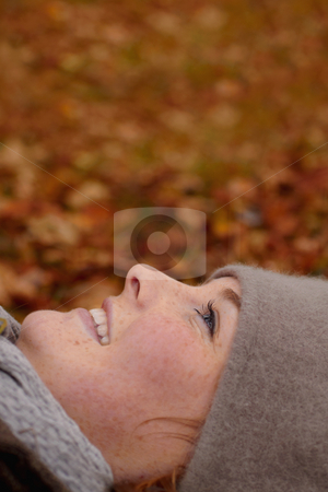 Beautiful young woman looking up at copy space stock photo, Fall - Beautiful young woman looking up at copy space by Phillip Dyhr Hobbs