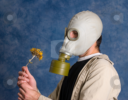 Dead stock photo, Concept image of death featuring a young man wearing a gas mask and holding a wilted flower by Richard Nelson