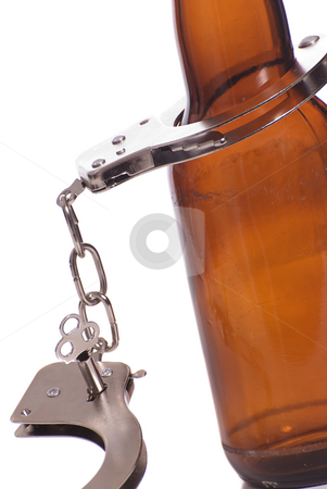 Drunk Driving stock photo, Concept image of drunk driving featuring a beer bottle and a pair of handcuffs, isolated against a white background by Richard Nelson