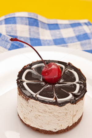 Fancy cake with cherry stock photo, Food serie: sweet fancy cake with chocolate icing and cherry by Gennady Kravetsky