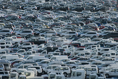 Carpark stock photo, Rows of brand new cars and trucks parked and waiting for delivery by Stephen Gibson