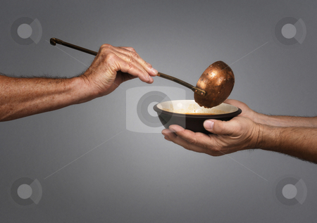 Feed the World stock photo, Man holding a bowl in both hands, receiving a serving of soup from another man holding a soup ladle by James Steidl