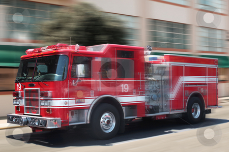 Red fire truck stock photo, Red fire truck rushing down street by James Steidl