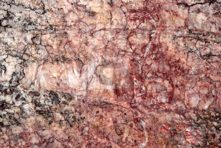 Pink and red natural cut marble rock texture. stock photo, Pink and red natural cut marble rock texture. by Stephen Rees