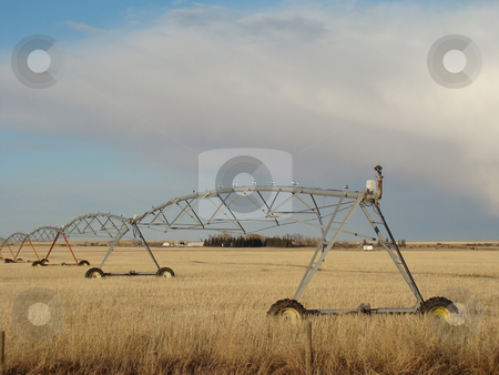 Prairie Irrigation System stock photo, Large irrigation system runs across a prairie field by CHERYL LAFOND