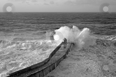Big Atlantic wave breaks on Portreath pier, Cornwall UK. stock photo, Big Atlantic wave breaks on Portreath pier, Cornwall UK. by Stephen Rees