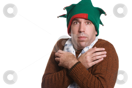 Cold Christmas stock photo, A man is cold and wearing only a sweater, an elf hat and a white scarf, all of which don't match, isolated against a white background by Richard Nelson