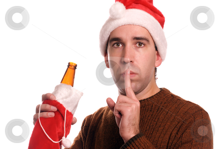 Christmas Alcoholic stock photo, Concept image of a young man wearing a Santa hat and holding a beer, telling the viewer to keep his secret about his problem by Richard Nelson