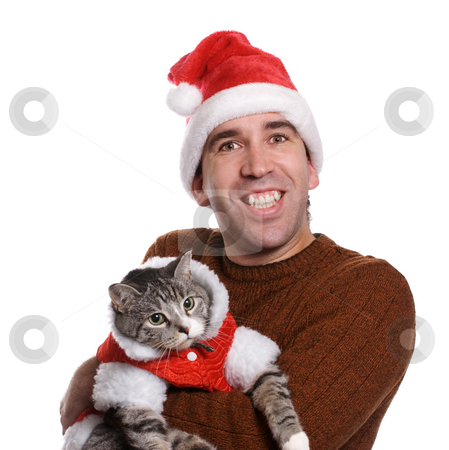 Chistmas Man and his Cat stock photo, A smiling young man wearing a santa hat and holding his cat, isolated against a white background by Richard Nelson