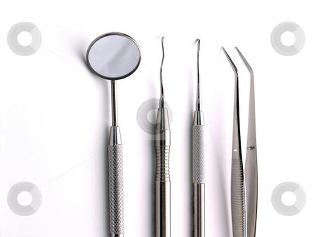 Dental Instruments stock photo, Close-up Dental Instruments on white background by Adam Radosavljevic