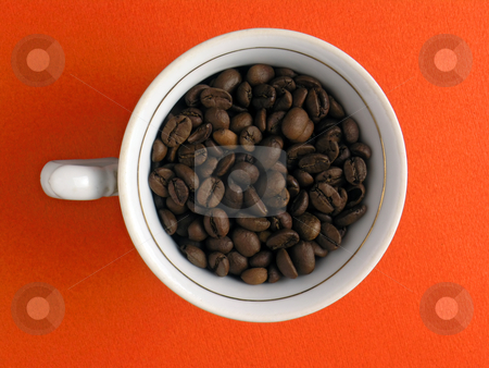 Cup of coffe-beans stock photo, Cup of coffe-beans on orange background by Adam Radosavljevic