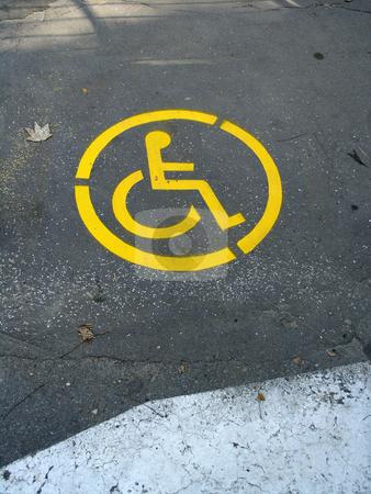 Wheelchair Symbol stock photo, Wheelchair Symbol on street by Adam Radosavljevic