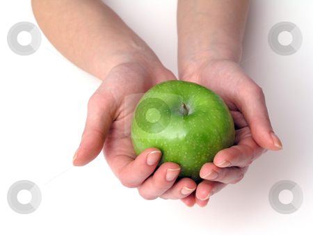 Apple in hand stock photo, Apple in hands on white background by Adam Radosavljevic