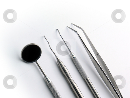 Dental Instruments stock photo, Close-up Dental Instruments on white background, angle by Adam Radosavljevic