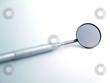 Angled mirror stock photo, Close-up of a dental mirror by Adam Radosavljevic