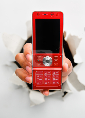 Breakthrough in telecommunication technology innovation stock photo, Hand holding new red cell phone mean breakthrough in telecommunication technology innovation - one of the breakthrough series by Rudyanto Wijaya